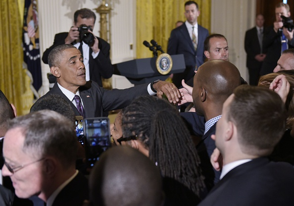US President Barack Obama greets attendees after speaking at a reception to mark LGBT month in the East Room of the White House on June 9, 2016 in Washington, DC. / AFP / Mandel Ngan (Photo credit should read MANDEL NGAN/AFP/Getty Images)