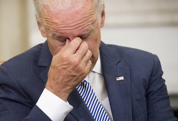 US Vice President Joe Biden attends a meeting with US President Barack Obama and top National Security officials about the investigation into the mass shooting in Orlando, Florida, in the Oval Office of the White House in Washington, DC, June 13, 2016. President Barack Obama said Monday there was no evidence that the massacre of 49 people in a Florida nightclub was directed from abroad or was part of a larger plot. / AFP / SAUL LOEB (Photo credit should read SAUL LOEB/AFP/Getty Images)