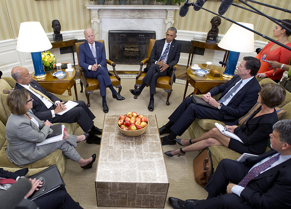"""U.S. President Barack Obama, center right, speaks to members of the media as U.S. Vice President Joseph """"Joe"""" Biden, center left, James Comey, director of the Federal Bureau of Investigation (FBI), middle right, and Jeh Johnson, U.S. secretary of Homeland Security (DHS), listen after receiving an update on the investigation into the attack in Orlando, Florida, in the Oval Office of the White House in Washington, D.C., U.S., on Monday, June 13, 2016. Obama said the gunman who killed 49 people in an Orlando nightclub was inspired by extremist propaganda but there's no evidence so far that he was directed by anyone overseas or was part of any larger group. Photographer: Ron Sachs/Pool via Bloomberg"""