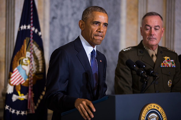 WASHINGTON, DC - JUNE 14: (AFP-OUT)US President Barack Obama (L) speaks on the Orlando shooting at the Treasury Department while Chairman of the Joint Chiefs of Staff General Joseph Dunford (R) look on, on June 14, 2016 in Washington, DC. Obama directly attacked Donald Trump's proposal to ban Muslims from entering the United States. (Photo by Jim Lo Scalzo-Pool/Getty Images)