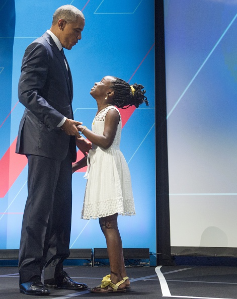 "US President Barack Obama embraces 11-year-old Mikaila Ulmer social entrepreneur of ""Me and the Bees Lemonade"" as he arrives to speak during the United State of Women Summit at the Washington Convention Center in Washington, DC, June 14, 2016. Ulmer, a 6th-grader from Austin, Texas signature venture, ""Me & The Bees"" lemonade, is now a thriving national business developed from her great-grandmother's 1940 recipe.. / AFP / SAUL LOEB (Photo credit should read SAUL LOEB/AFP/Getty Images)"