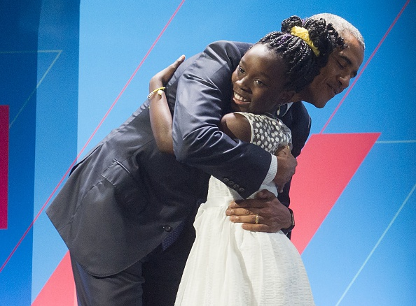 """US President Barack Obama embraces 11-year-old Mikaila Ulmer social entrepreneur of """"Me and the Bees Lemonade"""" as he arrives to speak during the United State of Women Summit at the Washington Convention Center in Washington, DC, June 14, 2016. Ulmer, a 6th-grader from Austin, Texas signature venture, """"Me & The Bees"""" lemonade, is now a thriving national business developed from her great-grandmother's 1940 recipe.. / AFP / SAUL LOEB (Photo credit should read SAUL LOEB/AFP/Getty Images)"""
