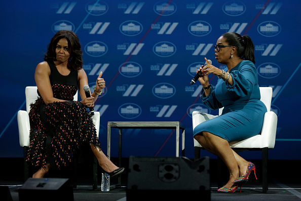 US First lady Michelle Obama (L) gestures next to Oprah Winfrey on a stage at the White House Summit on the United State of Women in Washington, DC on June 14, 2016. / AFP / YURI GRIPAS (Photo credit should read YURI GRIPAS/AFP/Getty Images)