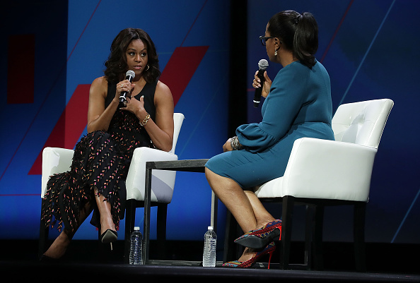 "WASHINGTON, DC - JUNE 14: U.S. first lady Michelle Obama (L) and Oprah Winfrey (R) participate in a conversation on ""Trailblazing the Path for the Next Generation of Women"" during the White House Summit on the United State Of Women June 14, 2016 in Washington, DC. The White House hosts the first ever summit to push for gender equality. (Photo by Alex Wong/Getty Images)"