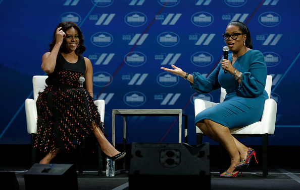 US First lady Michelle Obama (L) and Oprah Winfrey speak at the White House Summit on the United State of Women in Washington, DC on June 14, 2016. / AFP / YURI GRIPAS (Photo credit should read YURI GRIPAS/AFP/Getty Images)