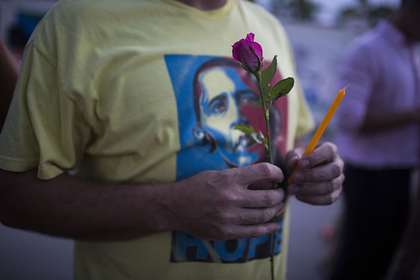 CHIANG MAI, THAILAND - JUNE 14: A man wearing an Obama shirt takes part in a candlelight vigil outside the United States Consulate on June 14, 2016 in Chiang Mai, Thailand. 49 people were killed after a gunman opened fire on people in a gay nightclub in Orlando. It was the deadliest mass shooting in U.S. history. (Photo by Taylor Weidman/Getty Images)