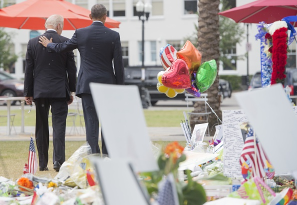 US President Barack Obama and Vice President Joe Biden leave after placing flowers for the victims of the mass shooting at a gay nightclub Sunday at a memorial at the Dr. Phillips Center for the Performing Arts in Orlando, Florida, June 16, 2016. / AFP / SAUL LOEB (Photo credit should read SAUL LOEB/AFP/Getty Images)
