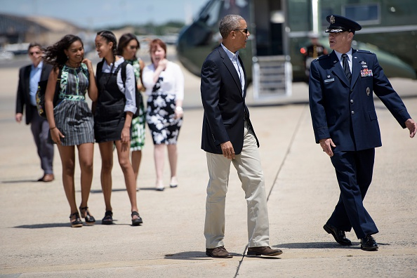 US President Barack Obama and the first family walk to Air Force One at Andrews Air Force Base, Maryland, on June 15, 2016, to travel to National Parks in New Mexico and California . / AFP / Brendan Smialowski (Photo credit should read BRENDAN SMIALOWSKI/AFP/Getty Images)