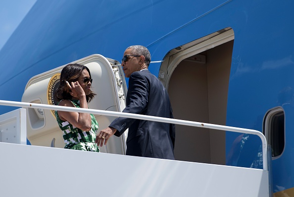 US First Lady Michelle Obama (L) and US President Barack Obama board Air Force One at Andrews Air Force Base, Maryland, on June 15, 2016, to travel to National Parks in New Mexico and California. / AFP / Brendan Smialowski (Photo credit should read BRENDAN SMIALOWSKI/AFP/Getty Images)
