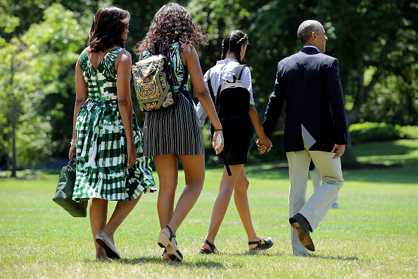 WASHINGTON, DC - JUNE 17: (L-R) U.S. first lady Michelle Obama, daughters Sasha Obama and Malia Obama, and President Barack Obama leave the White House before boarding Marine Oe on the South Lawn June 17, 2016 in Washington, DC. The first family is traveling to New Mexico and tour Carlsbad Caverns National Park to celebrate the 100th anniversary of the creation of America's national park system. (Photo by Chip Somodevilla/Getty Images)