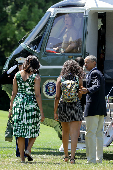 U.S. President Barack Obama, first lady Michelle Obama and their daughters Malia Obama and Sasha Obama leave the White House before boarding Marine Oe on the South Lawn June 17, 2016 in Washington, DC. The first family is traveling to New Mexico and tour Carlsbad Caverns National Park to celebrate the 100th anniversary of the creation of America's national park system.