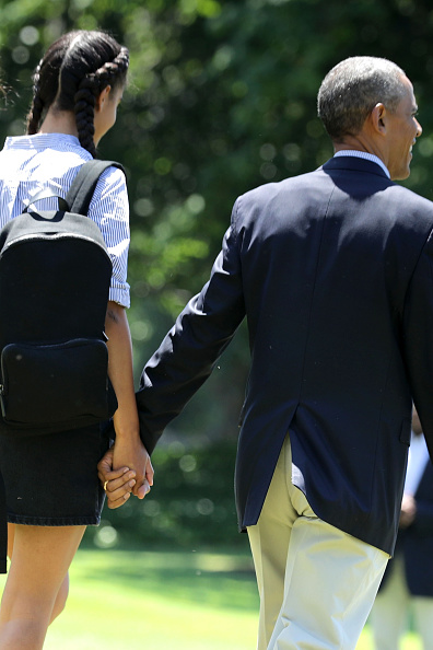 WASHINGTON, DC - JUNE 17: U.S. President Barack Obama (R) and his daughter Malia Obama walk out of the White House hand-in-hand before boarding Marine One on the South Lawn June 17, 2016 in Washington, DC. The first family is traveling to New Mexico and tour Carlsbad Caverns National Park to celebrate the 100th anniversary of the creation of America's national park system. (Photo by Chip Somodevilla/Getty Images)
