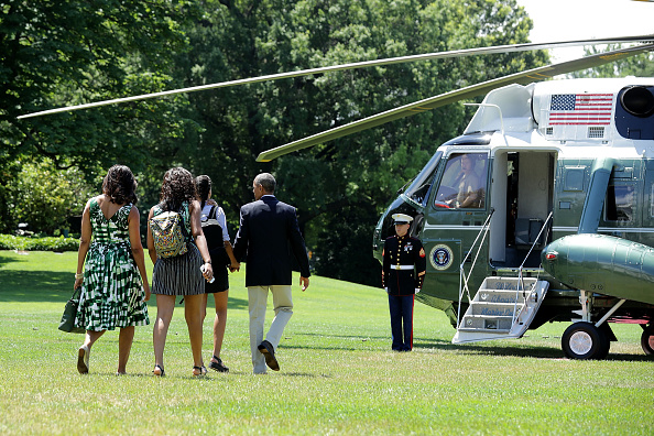WASHINGTON, DC - JUNE 17: (L-R) U.S. first lady Michelle Obama, daughters Sasha Obama and Malia Obama, and President Barack Obama leave the White House before boarding Marine One on the South Lawn June 17, 2016 in Washington, DC. The first family is traveling to New Mexico and tour Carlsbad Caverns National Park to celebrate the 100th anniversary of the creation of America's national park system. (Photo by Chip Somodevilla/Getty Images)