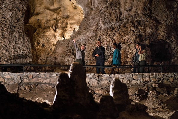A US Park Ranger gives US President Barack Obama (2L), Sasha Obama (C), first lady Michelle Obama (2R) and Malia Obama a tour of Carlsbad Caverns National Park on June 17, 2016 in Carlsbad, New Mexico. / AFP / Brendan Smialowski (Photo credit should read BRENDAN SMIALOWSKI/AFP/Getty Images)
