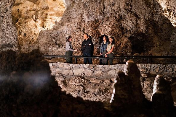 A US Park Ranger gives US President Barack Obama (2L), Sasha Obama (C), first lady Michelle Obama (2R) and Malia Obama a tour of Carlsbad Caverns National Park on June 17, 2016 in Carlsbad, New Mexico. / AFP / Brendan Smialowski (Photo credit should read BRENDAN SMIALOWSKI/AFP/Getty Images)