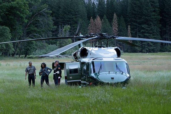 US President Barack Obama and first lady Michelle Obama arrive in Ahwahnee Meadow June 17, 2016 in Yosemite Vally, California. / AFP / Brendan Smialowski (Photo credit should read BRENDAN SMIALOWSKI/AFP/Getty Images)
