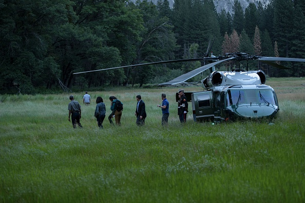 US President Barack Obama and the first family walk through Ahwahnee Meadow June 17, 2016 in Yosemite Vally, California. / AFP / Brendan Smialowski (Photo credit should read BRENDAN SMIALOWSKI/AFP/Getty Images)