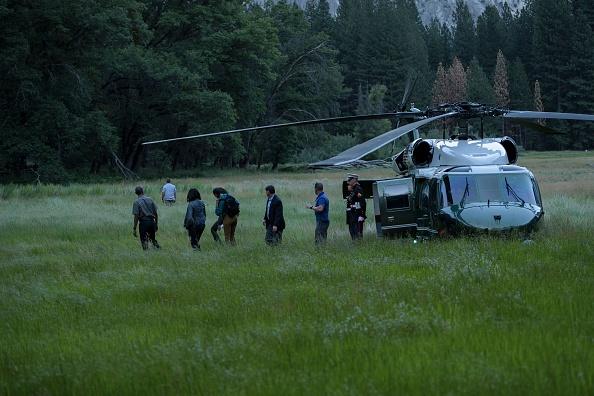 US President Barack Obama and the first family walk through Ahwahnee Meadow June 17, 2016 in Yosemite Vally, California. / AFP / Brendan Smialowski (Photo credit should read BRENDAN SMIALOWSKI/AFP/Getty Images)