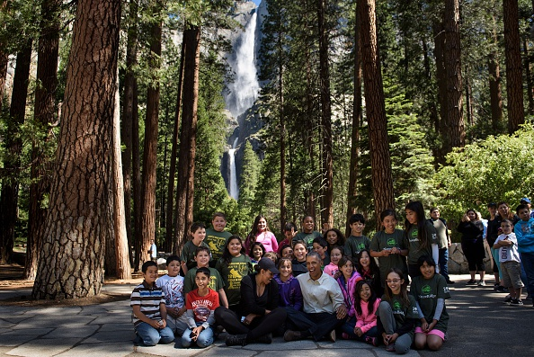 "US First Lady Michelle Obama and US President Barack Obama sit with children after speaking to them about the ""Every Kid in the Park"" initiative while celebrating the 100th year of US National Parks, on June 18, 2016, in Yosemite National Park, California. / AFP / Brendan Smialowski (Photo credit should read BRENDAN SMIALOWSKI/AFP/Getty Images)"