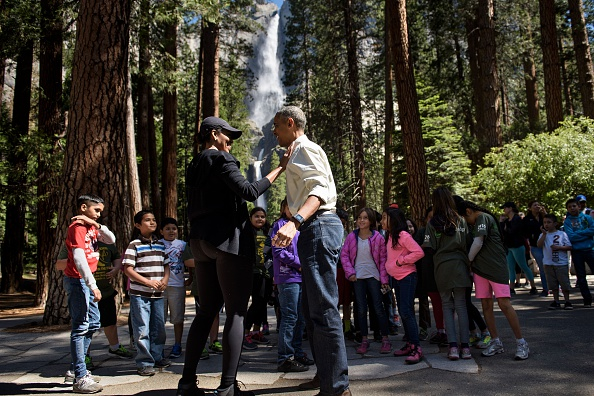 "US First Lady Michelle Obama and US President Barack Obama talk after speaking to children about the ""Every Kid in the Park"" initiative in Yosemite National Park, California, while celebrating the 100th year of US National Parks June 18, 2016. / AFP / Brendan Smialowski (Photo credit should read BRENDAN SMIALOWSKI/AFP/Getty Images)"