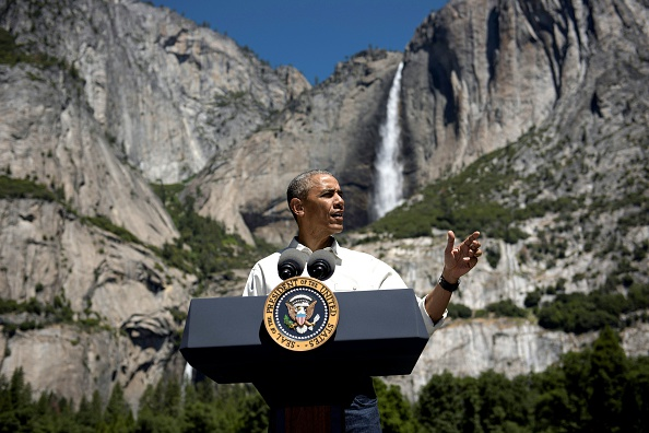 US President Barack Obama speaks while celebrating the 100th anniversary of the US National Parks system at Yosemite National Park, California, on June 18, 2016. / AFP / Brendan Smialowski (Photo credit should read BRENDAN SMIALOWSKI/AFP/Getty Images)