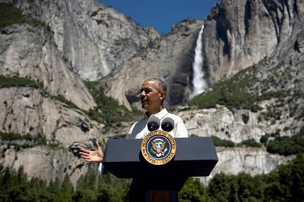 US President Barack Obama speaks while celebrating the 100th anniversary of the US National Parks system at Yosemite National Park, California, on June 18, 2016. / AFP / Brendan Smialowski (Photo credit should read BRENDAN SMIALOWSKI/AFP/Getty Images)
