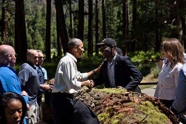US President Barack Obama greets guests after speaking while celebrating the 100th anniversary of the US National Parks system at Yosemite National Park, California, on June 18, 2016. / AFP / Brendan Smialowski (Photo credit should read BRENDAN SMIALOWSKI/AFP/Getty Images)