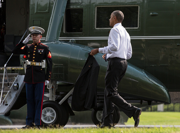 BETHESDA, MD - JUNE 21: (AFP OUT) U.S. President Barack Obama walks to Marine One after visiting wounded service members at Walter Reed National Military Medical Center on June 21, 2016 in Bethesda, MD. (Photo by Joshua Roberts - Pool/Getty Images)