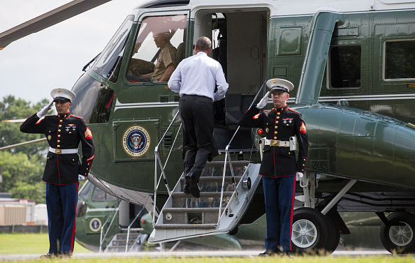 U.S. President Barack Obama boards Marine One after visiting wounded service members at Walter Reed National Military Medical Center in Bethesda, M.D., U.S. on Tuesday, June 21, 2016. Photographer: Joshua Roberts/Bloomberg