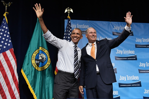 Washington Governor Jay Inslee waves with US President Barack Obama after introducing him at a fundraiser at the Washington State Convention Center in Seattle, Washington on June 24, 2016. / AFP / MANDEL NGAN (Photo credit should read MANDEL NGAN/AFP/Getty Images)