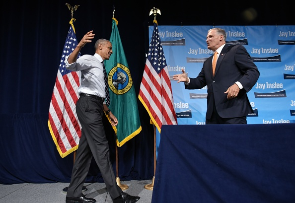 Washington Governor Jay Inslee (R) greets US President Barack Obama after introducing him at a fundraiser at the Washington State Convention Center in Seattle, Washington on June 24, 2016. / AFP / MANDEL NGAN (Photo credit should read MANDEL NGAN/AFP/Getty Images)