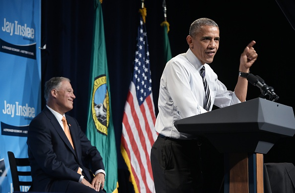US President Barack Obama speaks during a fundraiser for Washington Governor Jay Inslee (L) at the Washington State Convention Center in Seattle, Washington on June 24, 2016. / AFP / MANDEL NGAN (Photo credit should read MANDEL NGAN/AFP/Getty Images)