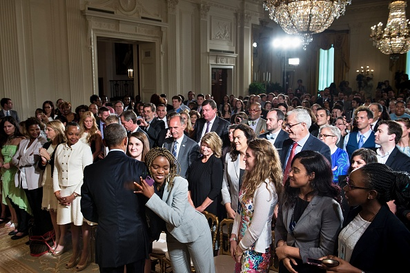 US President Barack Obama is hugged as he greets audience members after an event to celebrate the 2015 WNBA Champions, Minnesota Lynx, in the East Room of the White House June 27, 2016 in Washington, DC. / AFP / Brendan Smialowski (Photo credit should read BRENDAN SMIALOWSKI/AFP/Getty Images)