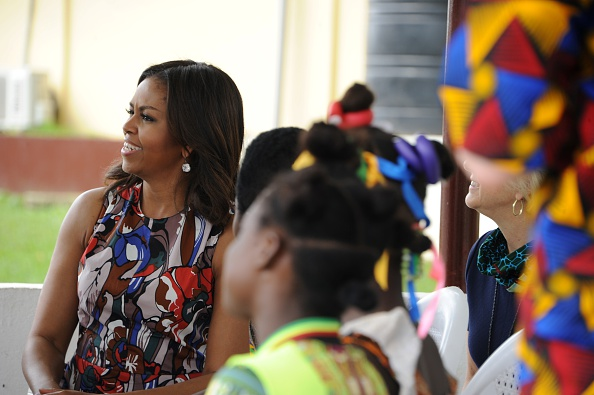 USA first lady Michelle Obama (L) looks on as she visits a woman education program in Monrovia on June 27, 2016. US First Lady Michelle Obama told girls in Liberia on Monday to fight to stay in school, as she visited the west African country where the vast majority drops out due to financial pressures. / AFP / OLIVIER MORIN (Photo credit should read OLIVIER MORIN/AFP/Getty Images)