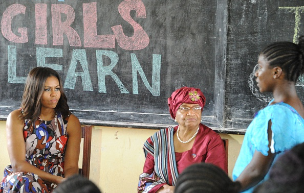 USA first lady Michelle Obama (L) looks on as she visits a woman education program in Monrovia on June 27, 2016. US First Lady Michelle Obama told girls in Liberia on Monday to fight to stay in school, as she visited the west African country where the vast majority drops out due to financial pressures. / AFP / ZOOM DOSSO (Photo credit should read ZOOM DOSSO/AFP/Getty Images)