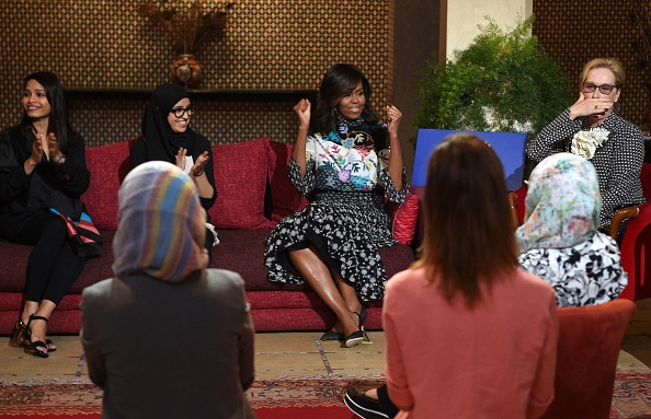 """US first lady Michelle Obama (C) and US actress Meryl Streep (R) meet with Moroccan young women following the """"Let Girls Learn"""" Program on June 28, 2016 in the Western Moroccan city of Marrakesh. US First Lady Michelle Obama began a two day visit to Morocco to participate in a CNN-moderated conversation with adolescent girls on the challenges they face in getting a quality education. / AFP / FADEL SENNA (Photo credit should read FADEL SENNA/AFP/Getty Images)"""