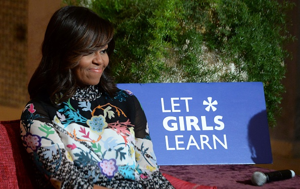"US first lady Michelle Obama smiles as she meets Moroccan young women following the ""Let Girls Learn"" Program on June 28, 2016 in the Western Moroccan city of Marrakesh. US First Lady Michelle Obama began a two day visit to Morocco to participate in a CNN-moderated conversation with adolescent girls on the challenges they face in getting a quality education. / AFP / FADEL SENNA (Photo credit should read FADEL SENNA/AFP/Getty Images)"