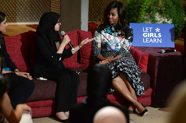 """US first lady Michelle Obama (R) listens to a Moroccan young woman following the """"Let Girls Learn"""" Program on June 28, 2016 in the Western Moroccan city of Marrakesh. US First Lady Michelle Obama began a two day visit to Morocco to participate in a CNN-moderated conversation with adolescent girls on the challenges they face in getting a quality education. / AFP / FADEL SENNA (Photo credit should read FADEL SENNA/AFP/Getty Images)"""