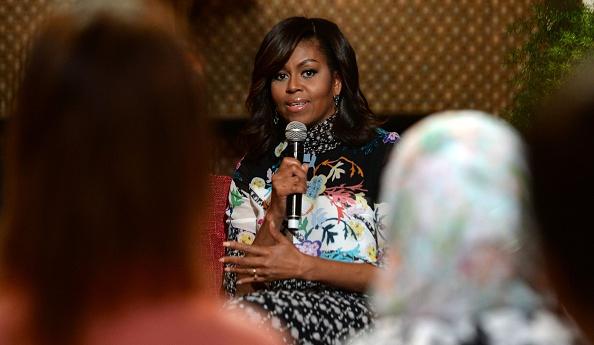 "US first lady Michelle Obama speaks as she meets with Moroccan young women following the ""Let Girls Learn"" Program on June 28, 2016 in the Western Moroccan city of Marrakesh. US First Lady Michelle Obama began a two day visit to Morocco to participate in a CNN-moderated conversation with adolescent girls on the challenges they face in getting a quality education. / AFP / FADEL SENNA (Photo credit should read FADEL SENNA/AFP/Getty Images)"