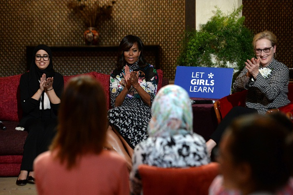 """US first lady Michelle Obama (C) and US actress Meryl Streep (R) applaud as they meet with Moroccan young women following the """"Let Girls Learn"""" Program on June 28, 2016 in the Western Moroccan city of Marrakesh. US First Lady Michelle Obama began a two day visit to Morocco to participate in a CNN-moderated conversation with adolescent girls on the challenges they face in getting a quality education. / AFP / FADEL SENNA (Photo credit should read FADEL SENNA/AFP/Getty Images)"""