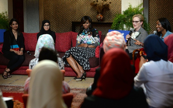 """US first lady Michelle Obama (C) and US actress Meryl Streep (2ndR) meet with Moroccan young women following the """"Let Girls Learn"""" Program on June 28, 2016 in the Western Moroccan city of Marrakesh. US First Lady Michelle Obama began a two day visit to Morocco to participate in a CNN-moderated conversation with adolescent girls on the challenges they face in getting a quality education. / AFP / FADEL SENNA (Photo credit should read FADEL SENNA/AFP/Getty Images)"""
