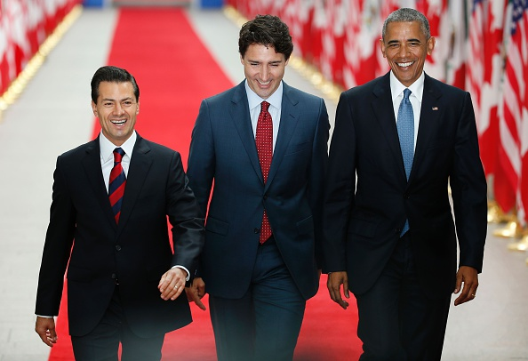 (L-R)Mexican President Enrique Pena Nieto, Canadian Prime Minister Justin Trudeau and US President Barack Obama arrive for the North American Leaders Summit and Leaders Summit at the National Gallery of Canada on June 29, 2016 in Ottawa, Ontario. / AFP / Chris Roussakis (Photo credit should read CHRIS ROUSSAKIS/AFP/Getty Images)