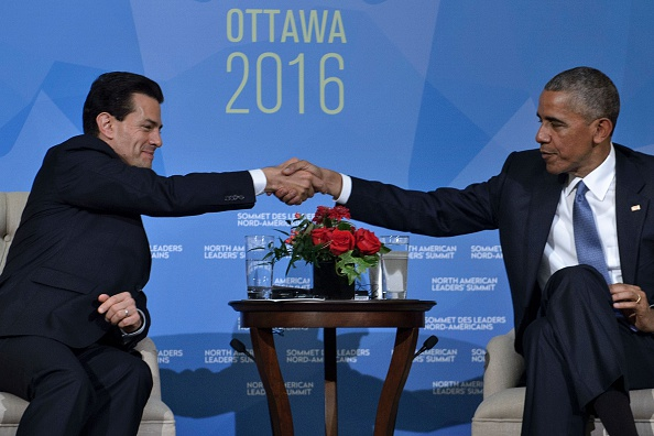 US President Barack Obama(R)and Mexican President Enrique Pena Nieto meet during the North American Leaders Summit at the National Gallery of Canada on June 29, 2016 in Ottawa, Ontario. / AFP / Brendan Smialowski (Photo credit should read BRENDAN SMIALOWSKI/AFP/Getty Images)