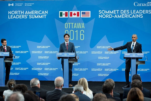 (L-R) Mexican President Enrique Pena Nieto, and Canadian Prime Minister Justin Trudeau look on as US President Barack Obama speaks during a trilateral press conference at the North American Leaders Summit at the National Gallery of Canada June 29, 2016 in Ottawa, Ontario. / AFP / Brendan Smialowski (Photo credit should read BRENDAN SMIALOWSKI/AFP/Getty Images)