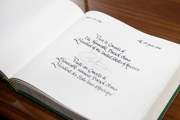 US President Barack Obama's signature is seen in a guest book at Parliament Hill while attending the North American Leaders Summit on June 29, 2016 in Ottawa, Ontario. / AFP / Brendan Smialowski (Photo credit should read BRENDAN SMIALOWSKI/AFP/Getty Images)