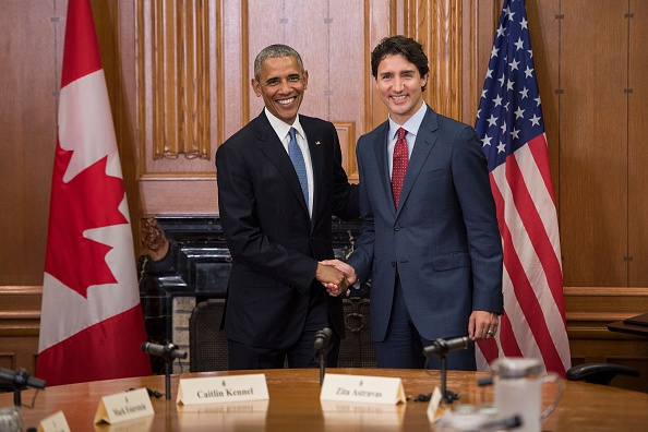 US President Barack Obama (L) and Canadian Prime Minister Justin Trudeau shake hands before a meeting in the Cabinet Room at Parliament Hill while attending the North American Leaders Summit on June 29, 2016 in Ottawa, Ontario. / AFP / Brendan Smialowski (Photo credit should read BRENDAN SMIALOWSKI/AFP/Getty Images)