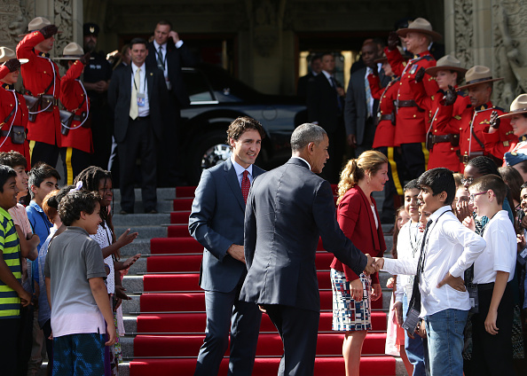 "Justin Trudeau, Canada's prime minister, center left, and U.S. President Barack Obama, center right, greet school children outside of Parliament Hill after the North American Leaders Summit (NALS) in Ottawa, Ontario, Canada, on Wednesday, June 29, 2016. Leaders from the three Nafta nations ""agree on the need for governments of all major steel-producing countries to make strong and immediate commitments to address the problem of global excess steelmaking capacity,"" according to a statement from Trudeau. Photographer: Cole Burston/Bloomberg via Getty Images"
