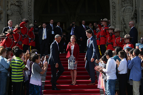 "U.S. President Barack Obama, from center left, Sophie Gregoire-Trudeau, and Justin Trudeau, Canada's prime minister, are applauded by school children outside of Parliament Hill after the North American Leaders Summit (NALS) in Ottawa, Ontario, Canada, on Wednesday, June 29, 2016. Leaders from the three Nafta nations ""agree on the need for governments of all major steel-producing countries to make strong and immediate commitments to address the problem of global excess steelmaking capacity,"" according to a statement from Trudeau. Photographer: Cole Burston/Bloomberg via Getty Images"
