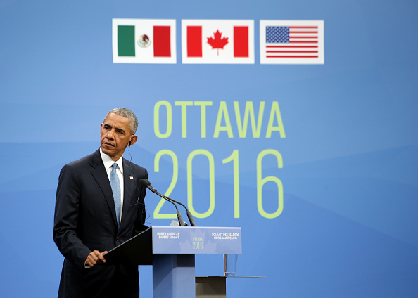 "U.S. President Barack Obama listens during a joint news conference with Enrique Pena Nieto, Mexico's president, not pictured, and Justin Trudeau, Canada's prime minister, not pictured, at the National Gallery of Canada during the North American Leaders Summit (NALS) in Ottawa, Ontario, Canada, on Wednesday, June 29, 2016. Leaders from the three Nafta nations ""agree on the need for governments of all major steel-producing countries to make strong and immediate commitments to address the problem of global excess steelmaking capacity,"" according to a statement from Trudeau. Photographer: Cole Burston/Bloomberg via Getty Images"