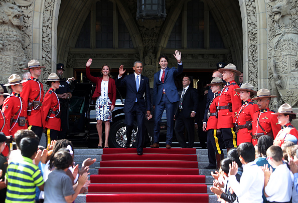 "Sophie Gregoire-Trudeau, from center left U.S. President Barack Obama, and Justin Trudeau, Canada's prime minister, greet school children outside of Parliament Hill after the North American Leaders Summit (NALS) in Ottawa, Ontario, Canada, on Wednesday, June 29, 2016. Leaders from the three Nafta nations ""agree on the need for governments of all major steel-producing countries to make strong and immediate commitments to address the problem of global excess steelmaking capacity,"" according to a statement from Trudeau. Photographer: Cole Burston/Bloomberg via Getty Images"